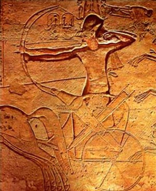 Egyptian horses and chariots: Ramses II fighting in a chariot at the Battle of Kadesh with two archers, one with the reins tied around his waist to free both hands. Relief from Abu Simbel.