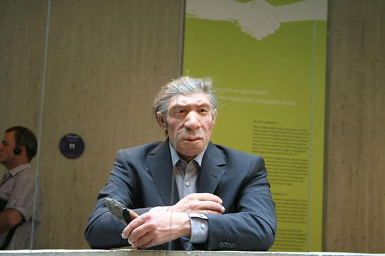 Could they pass unnoticed among us? Reconstruction of a Neanderthal man in a modern suit, at the Neanderthal Museum, Krapina, Croatia