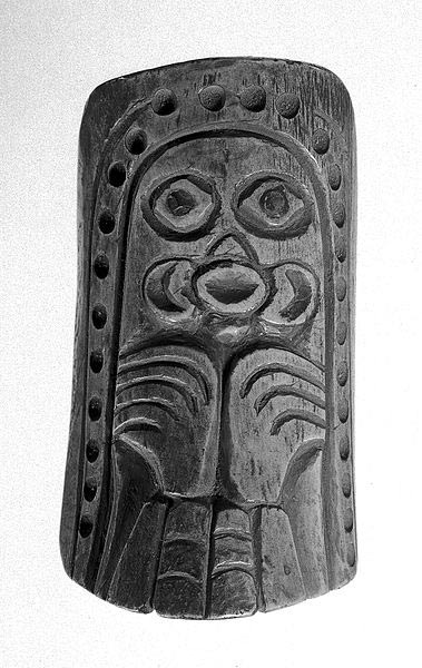 Shaman's totem charm of bone carved in British Columbia, Canada. Designs representing the octopus and bird. Abalone inlays in eyes. Hole pierced at top for pendant.