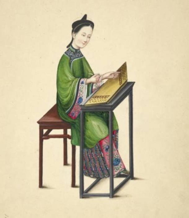 Watercolor illustration of a woman playing a zheng, or guzheng, a long, flat board instrument with strings of twisted silk.