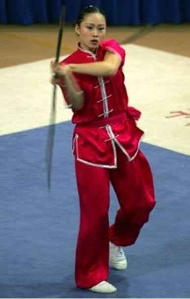 "Woman practices Wushu (traditional Chinese meaning ""martial art"")."