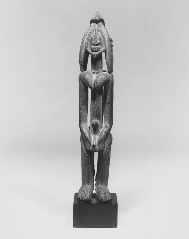 Figures like this one were placed on ancestral altars as links to a deceased person's soul. It is likely that this figure represents a Nommo, one of the first created beings, who, according to Dogon mythology, had a combination of male and female traits.