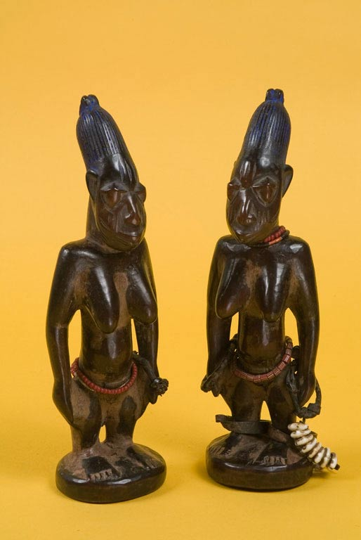 A pair of female Ere Ibeji twin figures.