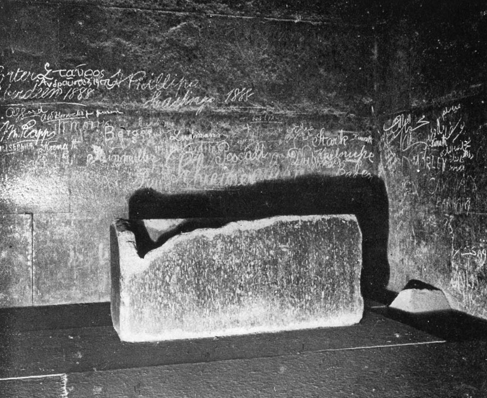 The sarcophagus in the King's Chamber. Graffiti from the 1800's cover the walls in this photo