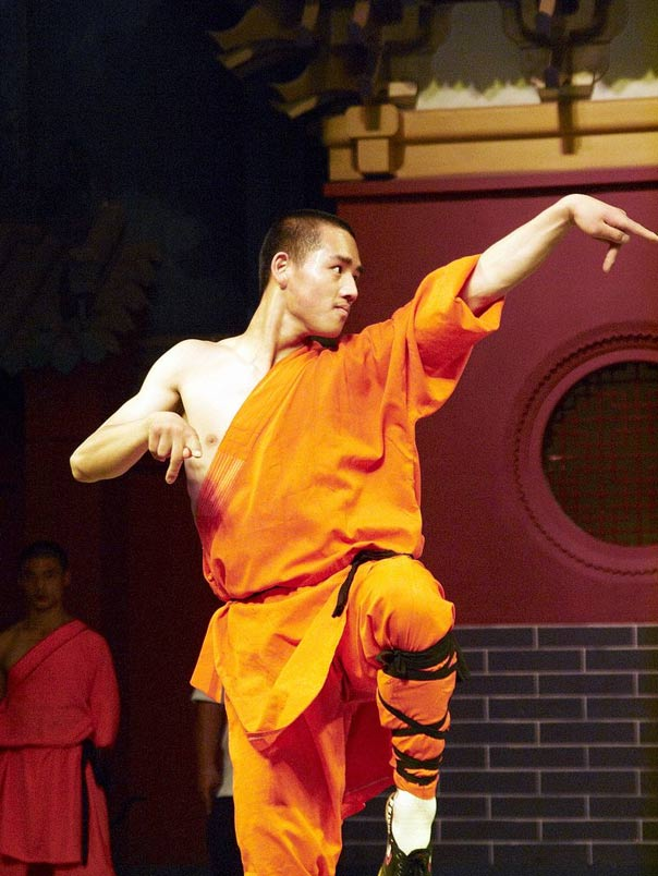 A shaolin student doing a Kung Fu moves.