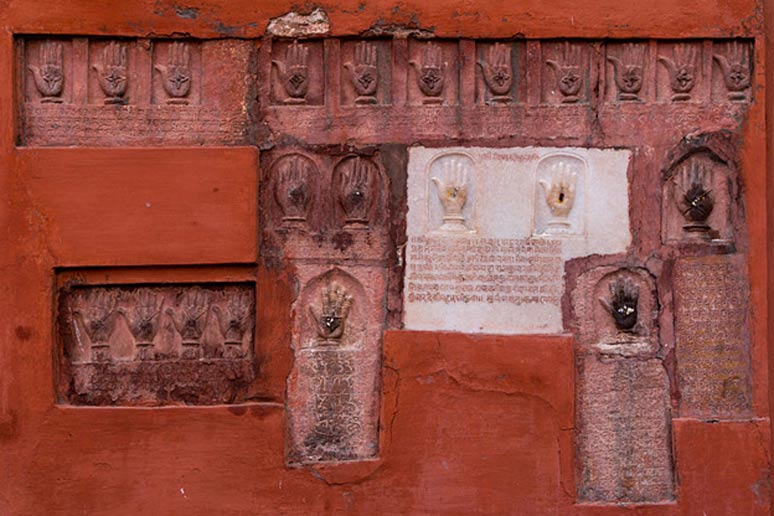 On the wall of the Daulat Pol (Daulat gate)l, are forty-one hand imprints of wives of the Maharajas of Bikaner, who committed/suffered suttee on the pyre of their husband who died in combat.